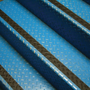 Blue social distancing mat beside lobby counter