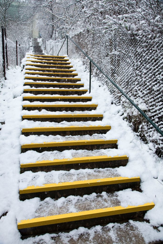 Grippy Stair Tread on stairs covered with snow/ice