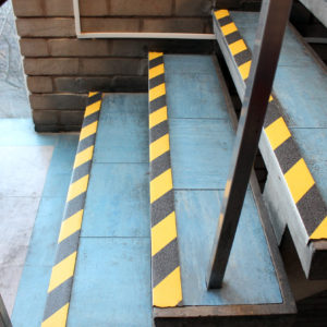 Hazardous tape on blue stair edges