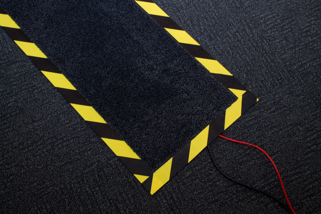 Wires covered by a hazardous marked mat