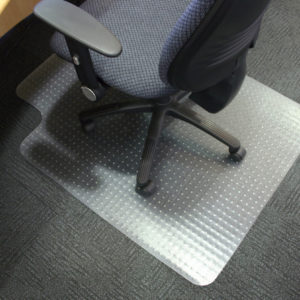 Chair on a mat on carpet flooring
