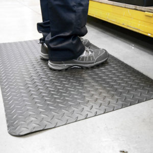 Person standing on a black Diamond Detailing Mat