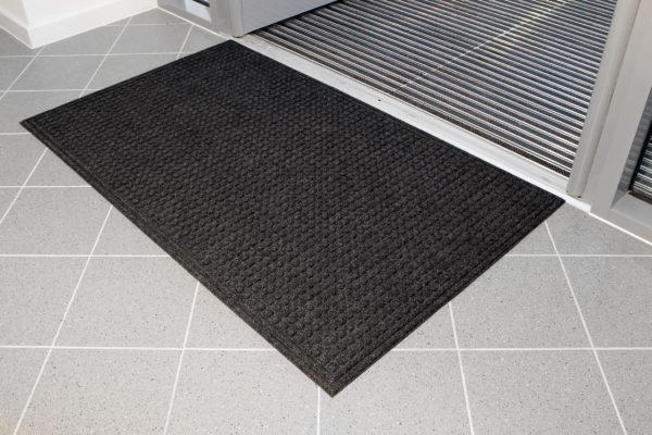 Black Eco-Doormat inside a door entrance