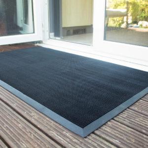 Black doormat outside bifolding doors