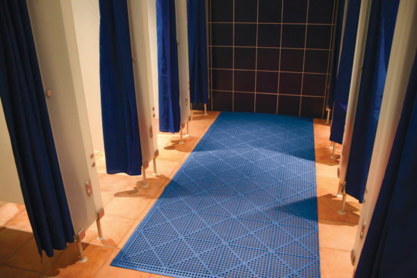 Blue mat in a communal shower floor or changing room