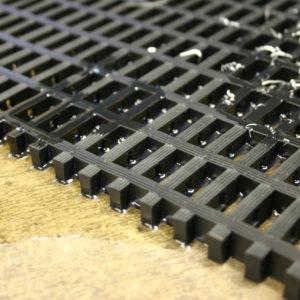 close up of black Heavy Duty Woven PVC Mat