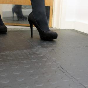 High heels walking on Interlocking tiles