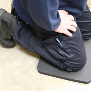 Man kneeling on a black Knee Protector Mat