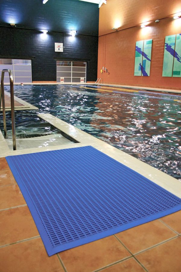 Blue leisure mat beside steps into a swimming pool