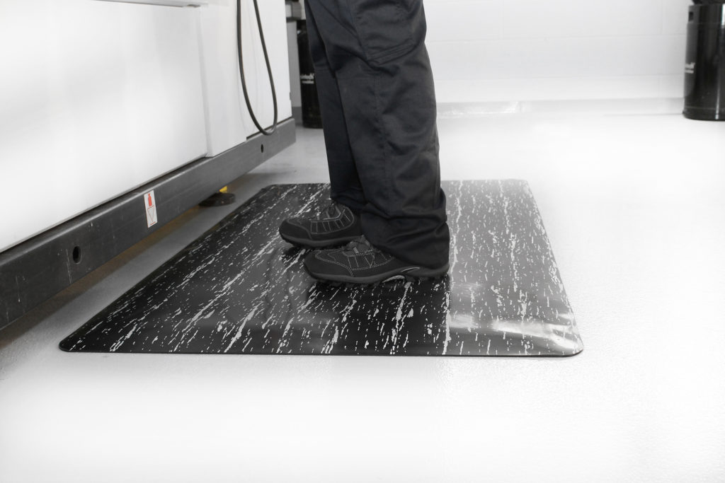 Man standing on a Marble Mat