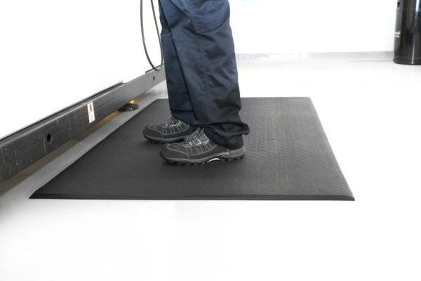 Man standing on a Black Orthomate Lite