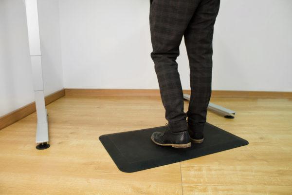 man standing on orthomat office mat