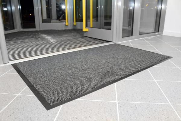 Steel coloured Plush Doormat outside building entrance