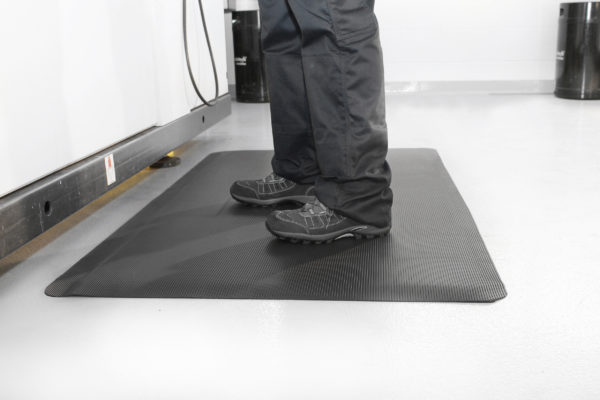Man standing on a lack Ramped Mat
