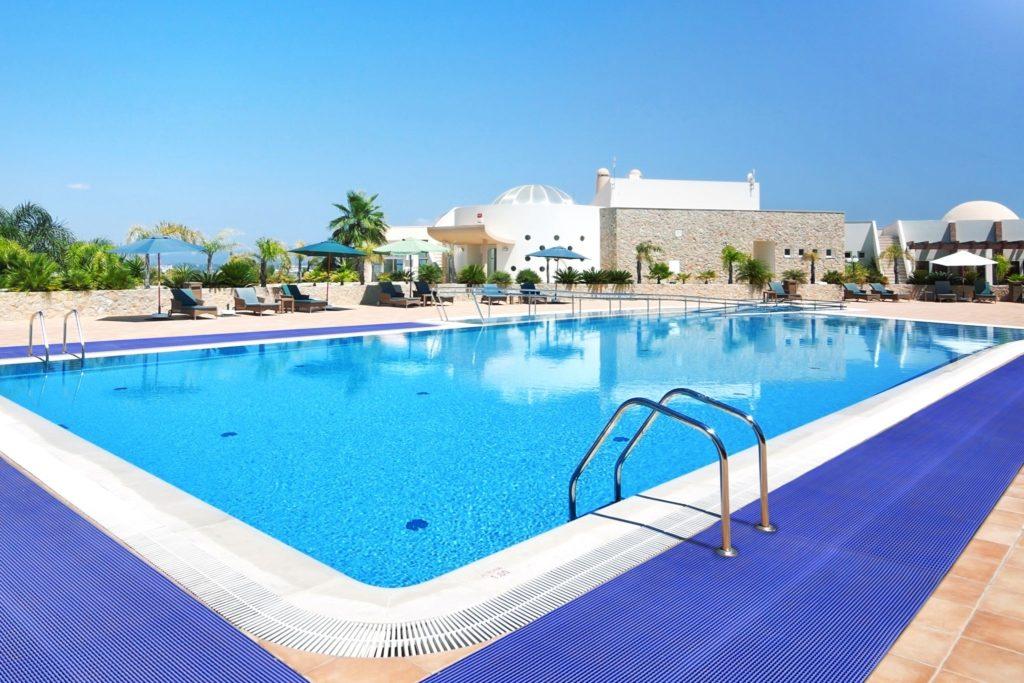 Blue mat surrounding a swimming pool