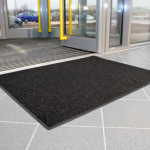 Charcoal Ribbed Carpet Doormat outside entry to a building
