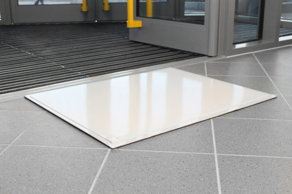 Sheeted Tack Cleaning Mat outside a building entrance
