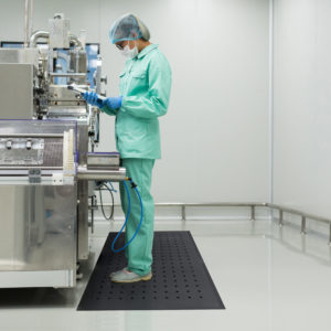 caucasian factory worker in blue lab suit on a solid hygienic Anti-Fatigue Mat