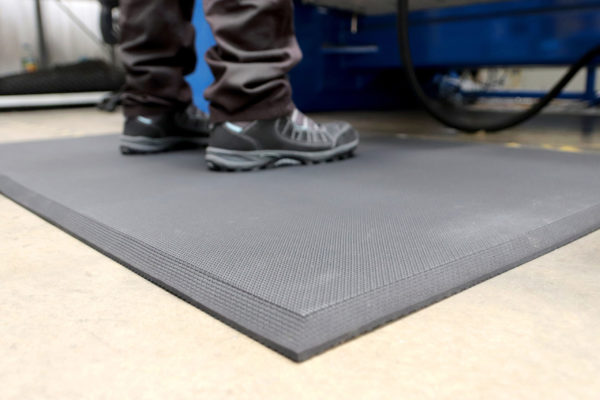 Person stood on a Solid Hygienic Anti-Fatigue Mat