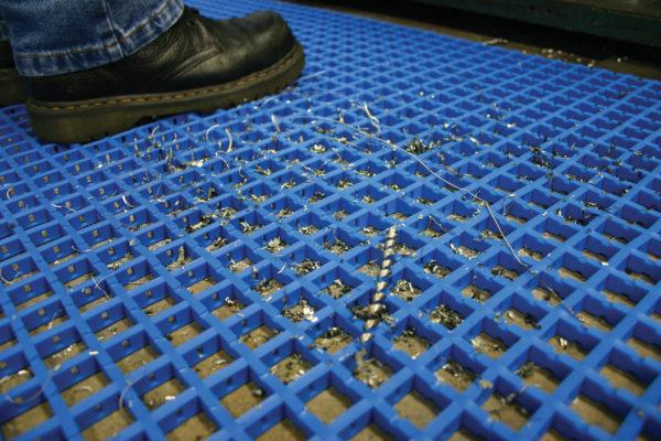 Man standing on blue Standard Woven PVC Mat