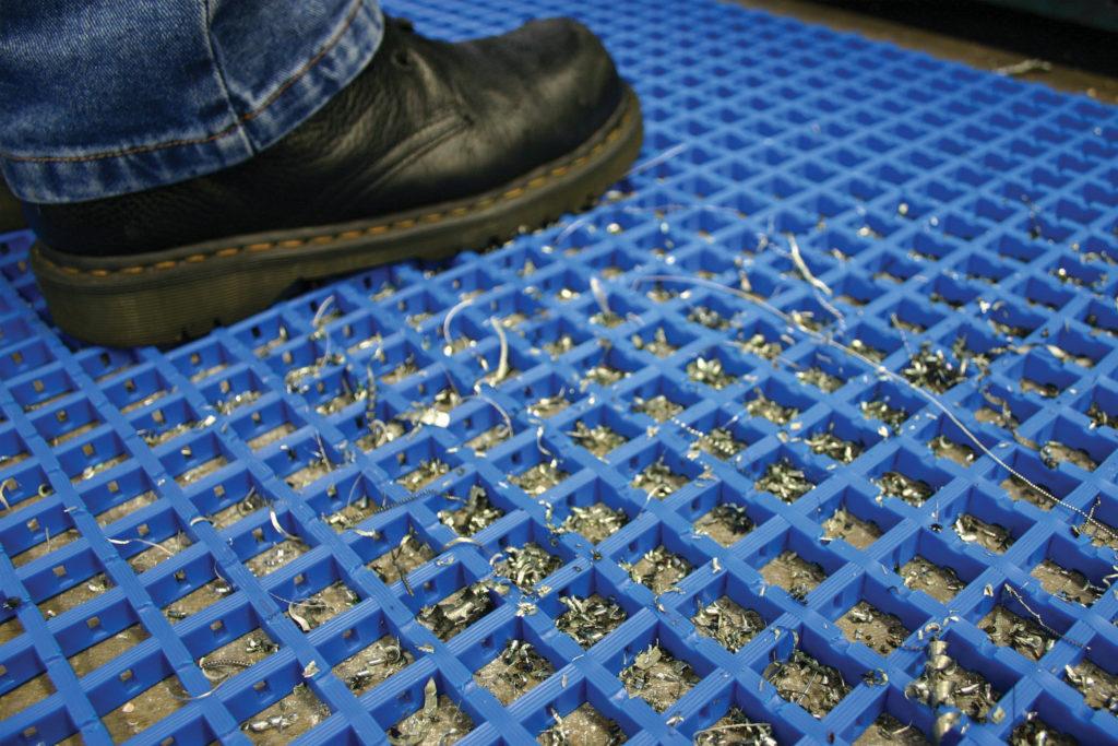 Man standing on a blue standard woven PVC anti-fatigue mat
