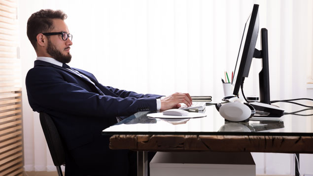 Man working at a sitting desk