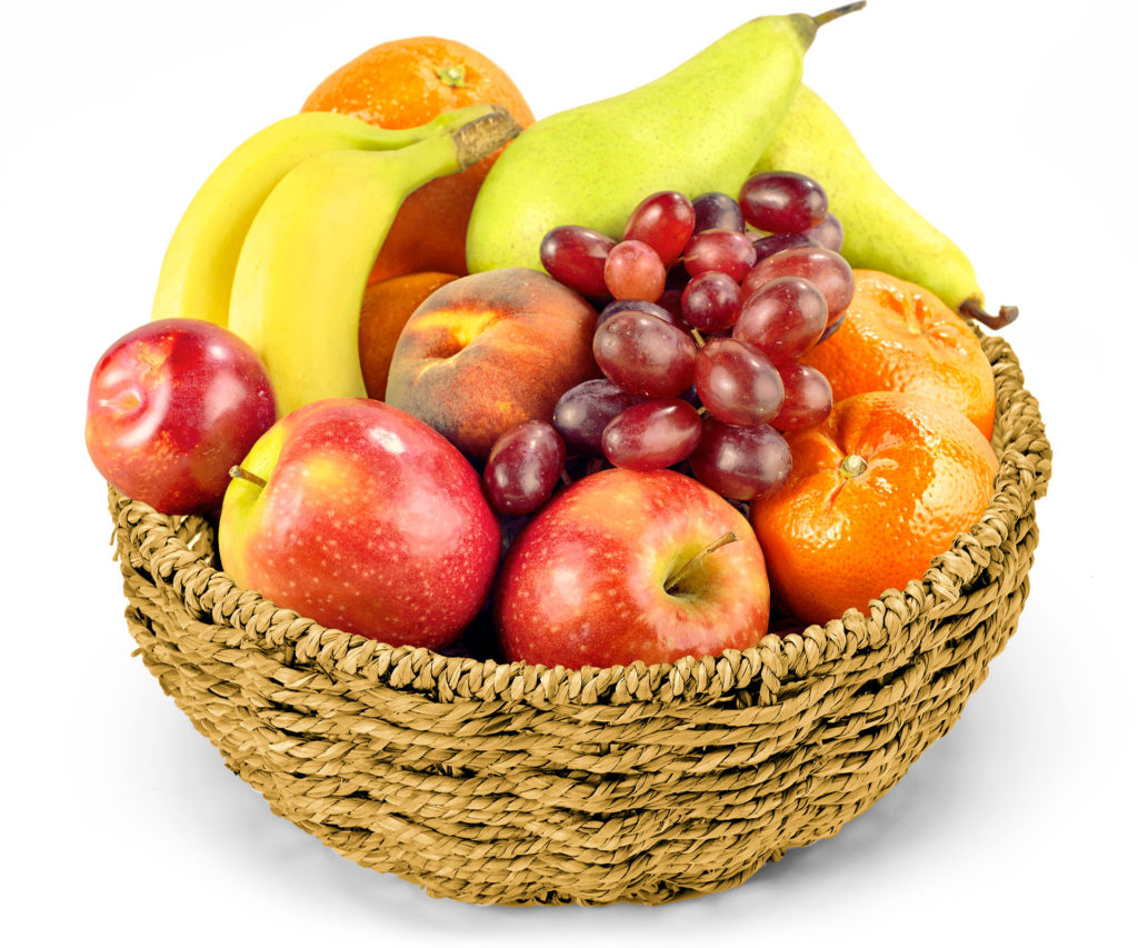 Pieces of different fruits in a wicker bowl